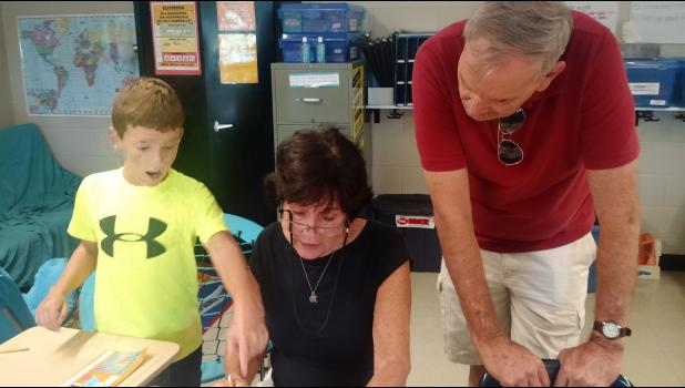 Fourth grader, Carter Kanoy with grandparents.