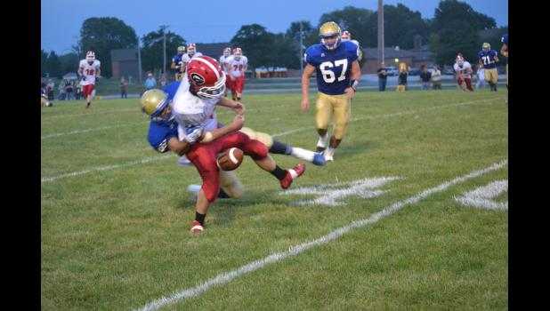 Linebacker Telly Harper #88 caused the Gallatin receiver to fumble the ball and Kenny Pulley #67 recovers it on the Hamilton 41 yard line.