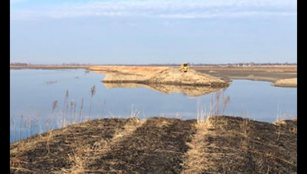 Months after the Missouri and Grand rivers returned to their banks, water remains standing alongside breached levees in west-central Missouri.