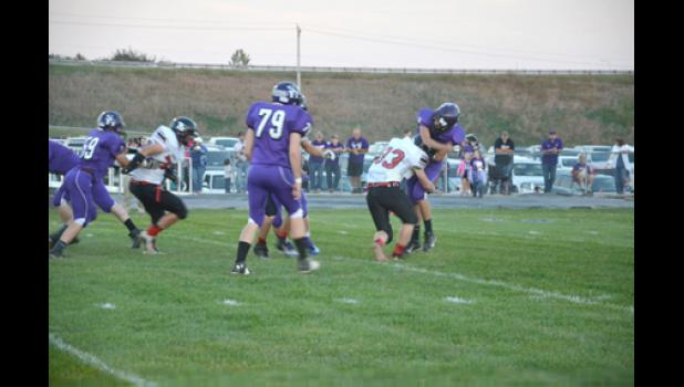 Shoe tackles the quarterback in the backfield.