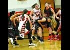 Brooklyn Moore fights for the ball against St. Joe Christian.
